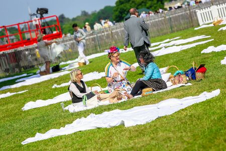 lady diana: CHANTILLY - JUNE 15: Group of people picnicking at the Prix de Diane - The Prix de Diane horse race is a French who runs Every year in June. In an atmosphere of sporting fervor and chic picnic Chantilly. Considered the price of elegance and distinction, t