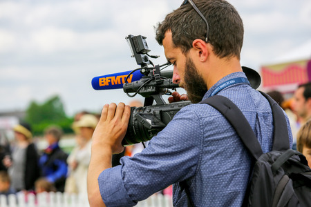 bourgeoisie: CHANTILLY - JUNE 15: Cameraman filming at the Prix de Diane - The Prix de Diane horse race is a French qui runs Every year in June. In an atmosphere of sporting fervor and chic picnic Chantilly. Considered the price of elegance and distinction, thanks to  Editorial