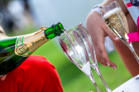 chantilly: CHANTILLY - JUNE 15: Close up on champagne bottle with glasses at the Prix de Diane - The Diana Award is a French horse race qui runs Every year in June. In an atmosphere of sporting fervor and chic picnic Chantilly. Considered the price of elegance and d