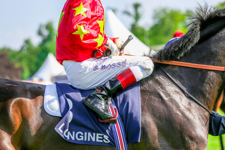 chantilly: CHANTILLY - JUNE 15: Close up of a jockey at the Prix de Diane - The Diana Award is a French horse race qui runs Every year in June. In an atmosphere of sporting fervor and chic picnic Chantilly. Considered the price of elegance and distinction, thanks to