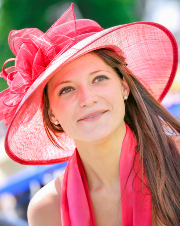 lady s: CHANTILLY - JUNE 15: Lovely woman with a pretty hat at the Prix de Diane - The Diana Award is a French horse race qui runs Every year in June. In an atmosphere of sporting fervor and chic picnic Chantilly. Considered the price of elegance and distinction,