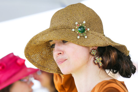 chantilly: CHANTILLY - JUNE 15: Lovely woman with a pretty hat at the Prix de Diane - The Diana Award is a French horse race qui runs Every year in June. In an atmosphere of sporting fervor and chic picnic Chantilly. Considered the price of elegance and distinction,