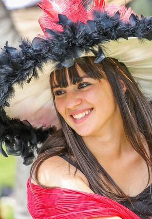 qui: CHANTILLY - JUNE 15: Lovely woman with a pretty hat at the Prix de Diane - The Diana Award is a French horse race qui runs Every year in June. In an atmosphere of sporting fervor and chic picnic Chantilly. Considered the price of elegance and distinction,