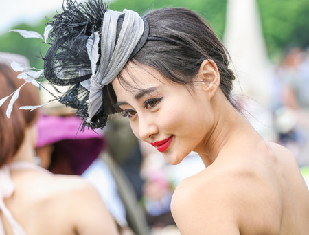 lady diana: CHANTILLY - JUNE 15: Lovely asian woman with a pretty hat at the Prix de Diane - The Diana Award is a French horse race qui runs Every year in June. In an atmosphere of sporting fervor and chic picnic Chantilly. Considered the price of elegance and distin