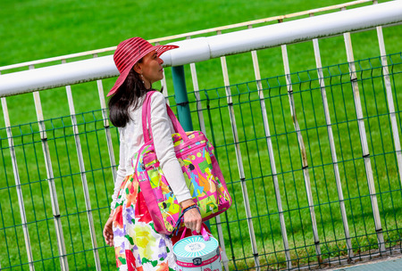 chantilly: CHANTILLY - JUNE 15: Lovely Stylish pretty woman with a hat at the Diane Prize Diane -The price is a French horse race qui runs Every year in June. In an atmosphere of sporting fervor and chic picnic Chantilly. Considered the price of elegance and distinc