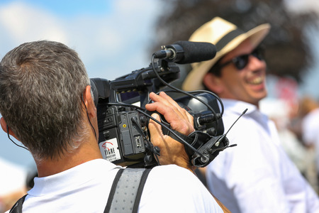chantilly: CHANTILLY - JUNE 15: Cameraman filming at the Prix de Diane - The Prix de Diane horse race is a French Who runs Every year in June. In an atmosphere of sporting fervor and chic picnic Chantilly. Considered the price of elegance and distinction, thanks to  Editorial