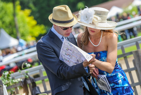 gambler: CHANTILLY - JUNE 15: Cute couple gambler at the Prix de Diane - The Prix de Diane horse race is a French Who runs Every year in June. In an atmosphere of sporting fervor and chic picnic Chantilly. Considered the price of elegance and distinction, thanks t