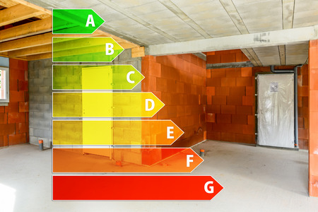 Real ecological house in construction with energy efficiency rating Stok Fotoğraf - 39304098