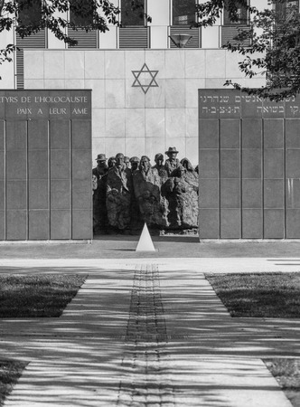 b w: PUTEAUX, FRANCE - MAY 10, 2015:  memorial of the martyrs of the Holocaust in Puteaux on which it is writing in French and Hebrew language (to the martyrs of the Holocaust, peace to Their Souls)
