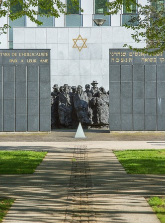 holocaust: PUTEAUX, FRANCE - MAY 10, 2015:  memorial of the martyrs of the Holocaust in Puteaux on which it is writing in French and Hebrew language (to the martyrs of the Holocaust, peace to Their Souls)