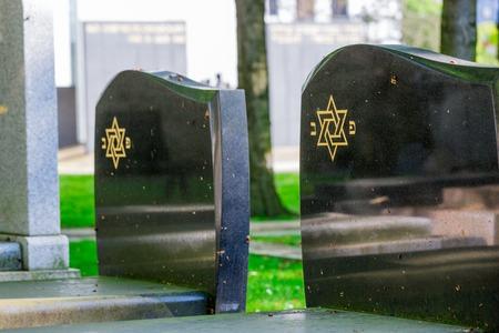 Jewish cemetery: Star of David on the tombstone Stock fotó