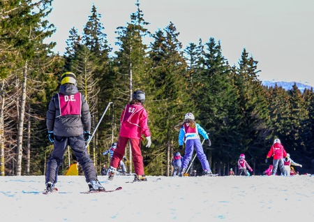 school form: GERARDMER, FRANCE - FEB 20 - French children form ski school groups during the annual winter school holiday on Feb 20 2015 in Gerardmer, France. Editorial