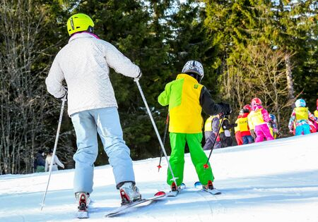 aplomb: GERARDMER, FRANCE - FEB 17- Closeup on beginner skier during the annual winter school holiday on Feb 17, 2015 in Gerardmer, France Editorial