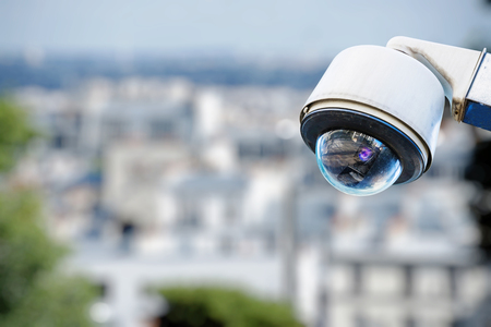 overseeing: security camera on a city Stock Photo