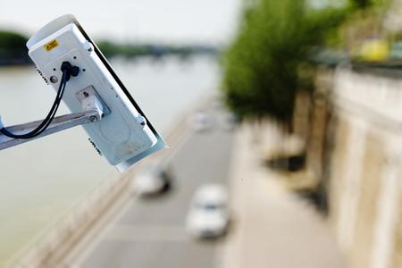 big brother spy: surveillance camera above a road