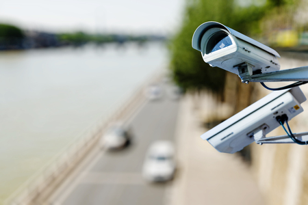 overseeing: surveillance camera above a road