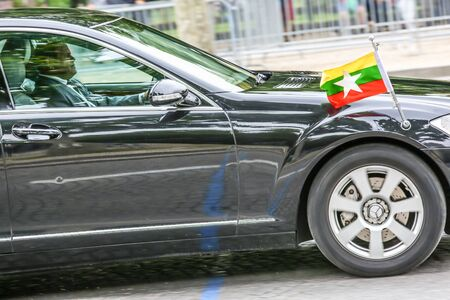 diplomatic: PARIS, FRANCE - JULY 14, 2014: Burma Diplomatic car during Military parade (Defile) in Republic Day (Bastille Day). Champs Elysees.