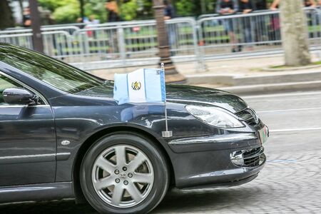 demonstrator: PARIS, FRANCE - JULY 14, 2014: Guatemala Diplomatic car during Military parade (Defile) in Republic Day (Bastille Day). Champs Elysees. Editorial