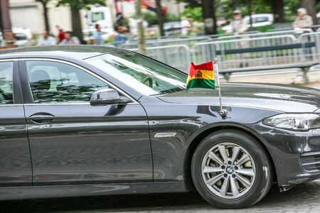 defile: PARIS, FRANCE - JULY 14, 2014: Bolivia Diplomatic car during Military parade (Defile) in Republic Day (Bastille Day). Champs Elysees.
