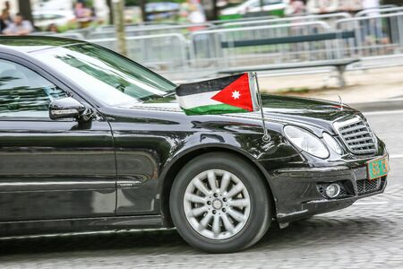 champs elysees: PARIS, FRANCE - JULY 14, 2014: Jordanian Diplomatic car during Military parade (Defile) in Republic Day (Bastille Day). Champs Elysees. Editorial