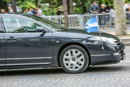 demonstrator: PARIS, FRANCE - JULY 14, 2014: Argentina Diplomatic car during Military parade (Defile) in Republic Day (Bastille Day). Champs Elysees. Editorial