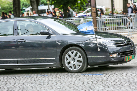 diplomatic: PARIS, FRANCE - JULY 14, 2014: Argentina Diplomatic car during Military parade (Defile) in Republic Day (Bastille Day). Champs Elysees. Editorial