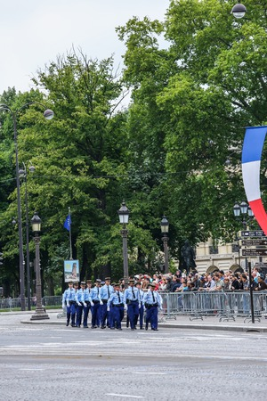 constable: PARIS, FRANCE - JULY 14, 2014: Military parade of National Gendarmerie (Defile) during the ceremonial of french national day, Champs Elysee avenue. Editorial