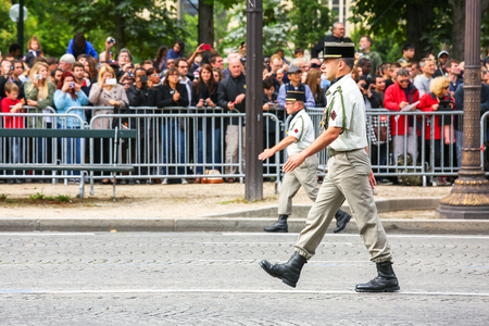 PARIS, FRANCE - JULY 14, 2014: officers Military parade (Defile) during the ceremonial of french national day, Champs Elysee avenue. Éditoriale