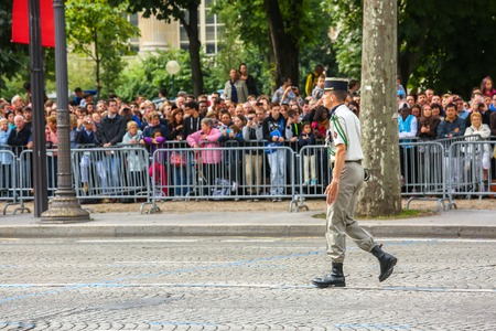 colonel: PARIS, FRANCE - JULY 14, 2014: Colonel in Military parade (Defile) during the ceremonial of french national day, Champs Elysee avenue. Editorial