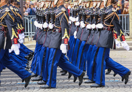 defile: PARIS, FRANCE - JULY 14, 2014: Military parade (Defile) during the ceremonial of french national day, Champs Elysee avenue. Editorial