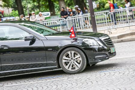 demonstrator: PARIS, FRANCE - JULY 14, 2014: Diplomatic car during Military parade (Defile) in Republic Day (Bastille Day). Champs Elysees.