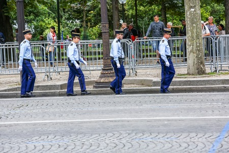 defile: PARIS, FRANCE - JULY 14, 2014: Military parade of National Gendarmerie (Defile) during the ceremonial of french national day, Champs Elysee avenue. Editorial