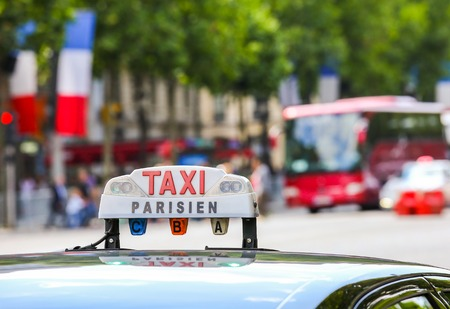 Parisian taxi in the city Editorial