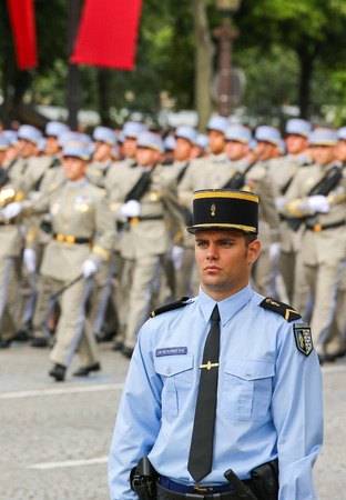 constable: PARIS, FRANCE - JULY 14, 2014: Military parade (Defile) during the ceremonial of french national day, Champs Elysee avenue. Editorial