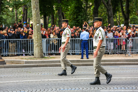 defile: PARIS, FRANCE - JULY 14, 2014: officers Military parade (Defile) during the ceremonial of french national day, Champs Elysee avenue. Editorial