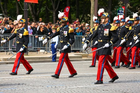 PARIS, FRANCE - JULY 14, 2014: Military parade (Defile) during the ceremonial of french national day, Champs Elysee avenue. 新闻类图片