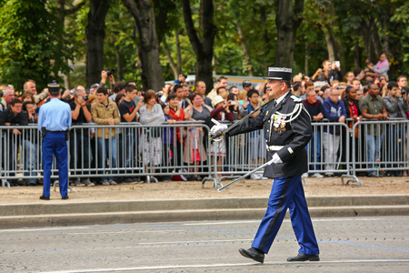 defile: PARIS, FRANCE - JULY 14, 2014: Captain Military parade of National Gendarmerie (Defile) during the ceremonial of french national day, Champs Elysee avenue.