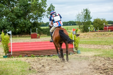 eventing: Rider with horse during a cross country manisfestation Editorial