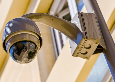 larceny: closeup on security CCTV camera or surveillance system in office building