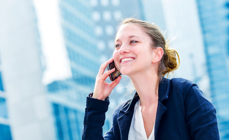 dynamic young executive calling outside, free of any constraint. Symbolizing a job search or a trade of outsourcing Stock Photo