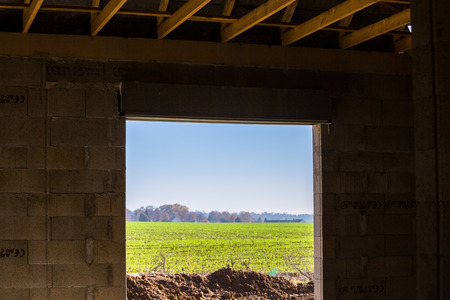 comtemporary: viewing the outside field  on a sunny day from a building still under construction Stock Photo