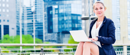 openspace: panoramic view on dynamic young executive girl working outside free of any constraint. Symbol of a job search or trade of outsourcing Stock Photo