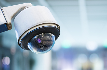 closeup image of CCTV security camera with blurred background
