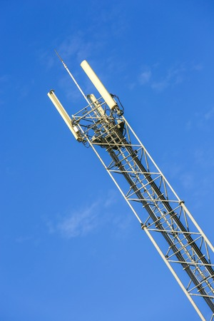 A high telecommunication network antenna and the beautiful clear blue sky Stock Photo