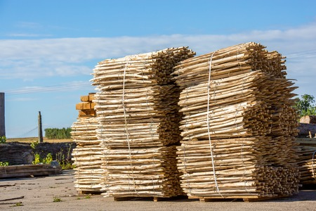 Stack of Wooden Fence Posts Close Up Stock Photo