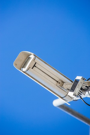 close up image of CCTV security camera fixed on a pole metalic