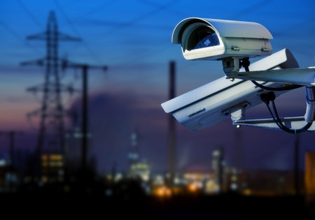 closeup on security CCTV camera or surveillance system for industrial site protection