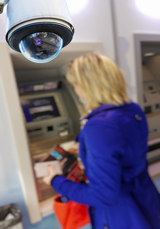 bank records: closeup on security CCTV camera or surveillance system in local cash dispenser