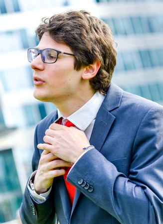 executive search: dynamic young leader adjust his tie before a job interview or business meeting