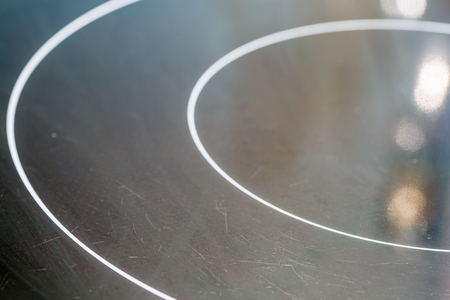 Surface of black electric and inductive hob. Domestic equipment.